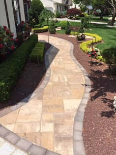 Imagine strolling down your walkway, surrounded by a beautiful garden that you created! This beautiful Cambridge Pavingstones walkway is a perfect complement to the flower beds.