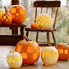 These pumpkins got a mod makeover with geometric cutouts in different sizes and patterns. Just hollow out the pumpkins, then stencil on your designs. Cut out each square with a pumpkin-carving saw and arrange on your front porch. For a country-chic look, rest pumpkins on an antique wooden chair or bench./