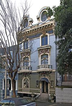 An elegant example of a Second Empire style Victorian is the Western Addition apartment house San Francisco. This house was designed by James Francis Dunn in the late 1890s. It has oeil de boeuf windows in the mansard roof, carved faces and caryatids, ornate French windows, and a canopy over the entrance.