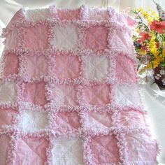 Just Pink Quilt - the quilt website has a great tutorial on making a rag quilt