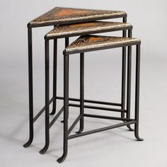 Bon Nesting Tables by Pulaski. $451.50. Warm medium wood stain. Nesting tables. Hand made. Hand forged decorative three legged metal base. Hardwoods and veneers construction. Bon Nesting TablesCocoa twig inlaid topsMortise and tenon jointDistressed finishThree tables fit togetherAssembled Size Height 28 in.Assembled Size Width 21 in.Assembled Size Length 24 in.Table top WoodShipping Dimensions 28 in. H x 24 in. W x 21 in. DStyle Contemporary / ModernShape TriangularFinish Other