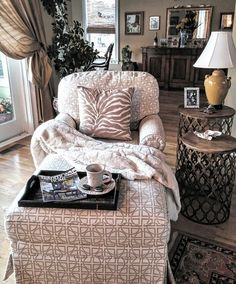 Baby it's cold outside! Snuggling up with #traditionalhomemagazine , coffee and cookies. Zebra pillow from Home Goods, throw from Tuesday Morning, nesting tables from Wayfair.