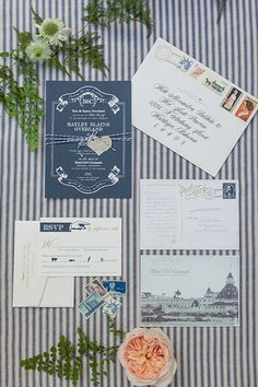 A white, navy and gold wedding invitation suite introduce the vintage glam theme | @shewanders | Brides.com