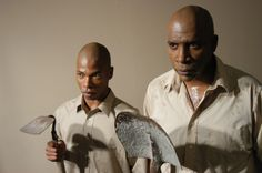 AAPACT's debut theatrical stage production was Athol Fugard's The Island. The play was directed by Andre' L. Gainey and featured actors Kristoff Skalet and Teddy Harrell, Jr. Photographed by Juan E. Cabrera. circa 2001 or 2002.