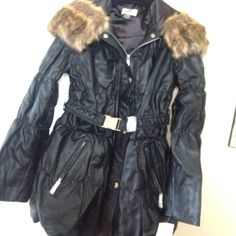 NWT 100% Genuine Leather Faux Fur puffer coat NWT 100% Genuine Leather Faux Fur Hood Puffer Coat with with Fur trim hood and a belt with a silver buckle. NEVER WORN ! Also have receipt and box if buyer wants with purchase✔️ Neiman Marcus Jackets & Coats