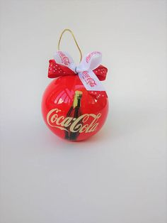Check out this item in my Etsy shop https://www.etsy.com/listing/565489085/coca-cola-christmas-ornament-coca-cola