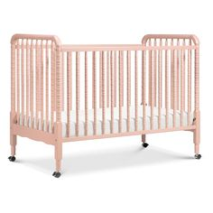 DaVinci's beloved Jenny Lind 3-in-1 Convertible Crib brings classic, vintage-inspired charm to the nursery. Signature heirloom style and solid wood spindle posts are paired with easy assembly and convertibility for use beyond the nursery years. Crib converts to a toddler bed and day bed, with wheels included for mobility. Match with the Jenny Lind Changing Table to complete the collection. Jenny Lind Crib, Pink Crib, Portable Crib, Cherry Finish, Convertible Crib, Crib Mattress, Baby Cribs, Baby Bassinet, Baby Furniture