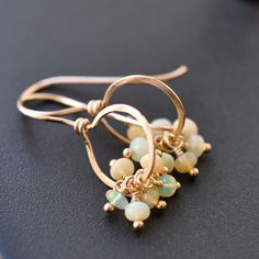 inspiration of opaline beads on head pins wired to a gold earring loop