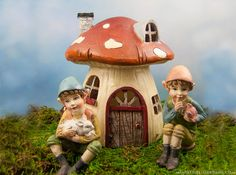 Mushroom Fairy House with little elves in the fairy garden.