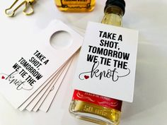 Take a shot, tomorrow we tie the knot wedding rehearsal dinner drink hang tags are all the rage! Assembling these mini alcohol gift favors will take little to no time, hang the tag on your favorite liquor bottle an add your ribbon, twine or cord, it's that simple! Available in cream, kraft or white card stock. Designed to fit the bottle neck of MOST 50ml miniature whiskey bottles. (Tag only provided)