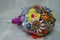 This is a very cool bouquet that I created with authentic, Vintage brooches!!! It contains over 40 pins and is available for sale,,,I do make more of these and they can be any color, or style you want.. You can find me on Facebook at Just Cause Jewelry Designs,, and I also create recycled jewelry as a hobby and I LOVE what I do:)