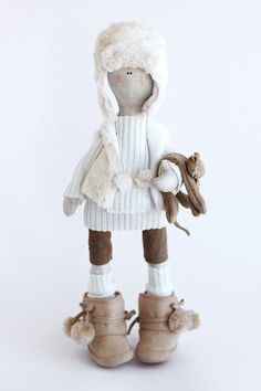 I like this doll because of her cute boots and feet bigger than her head
