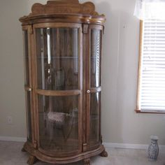 Vintage Bow glass curio cabinet/china cabinet/display cabinet/carved oak/paw foot  on etsy $1224