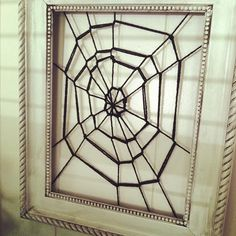 Framed spider web done in like 5 minutes!