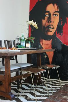 AshleyAnnHouseTour, it doesn't show the black and white zig zag rug or the full table and chairs.  I love the table and Bob Marley pop art though!