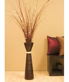 @Overstock.com - This floor vase with mini roses is the perfect addition to your home decor Set features 28-inch tall vase made from natural bamboo Stems of mini white roses, palm stalks, white willow buds, and dark branches add a touch of elegancehttp://www.overstock.com/Home-Garden/Mini-Roses-in-Plantation-Floor-Vase/2606273/product.html?CID=214117 $62.99