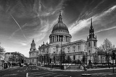 Contrails (clouds produced by airplanes) above St. Paul's Cathedral.
