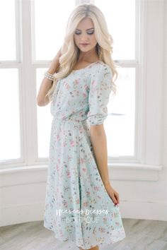 This dress is beyond beautiful! The pastel colors are so soft and just what you are looking for for spring and summer. This dress would be perfect for Easter or for floral bridesmaids dresses too! Light mint dress features a pink, white, sage floral.