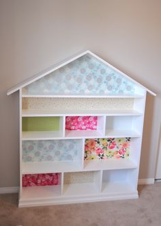 """Dollhouse bookcase.  4'x5' high.  Made from MDF and """"wallpapered"""" with dollar store wrapping paper and Mod Podge."""