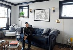 "Matthew sits in his sunny one-bedroom apartment in Avondale, Chicago. ""I take inspiration from Scandinavian design, filled with items that make me feel happy, personal and friend's travels, and lots and lots of plants!"""