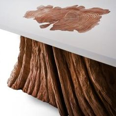 Bloom coffee table. A salvaged cedar tree base is fused with a rectangular, white resin top. Love the detailing of the trunk texture. by betsy