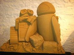 Photo by Norbert Schnitzler/Flickr. There have been many Disney-themed sand sculpture festivals, but only one is a yearly event sponsored by Disneyland Paris. The festival takes place at the Ostend beach in Belgium. At the 2012 event, WALL-E and Eve were there to watch over things.