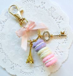 This is a cute pastel macaron trio and Eiffel Tower and key purse charm or keychain. Handmade by me with polymer clay. Its a little over 3 1/2 inches from top of clip to bottom of macarons. Comes with lobster claw clasp (to attach to purse strap or anything you want) and a 20mm key ring. You can request other colors than shown, Ill be posting new colors soon too. :) ** Made to order, so may look slightly different from one shown.  PLEASE READ FOR SHIPPING TIME- ***MY TURNAROUND TIME right…