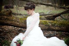 wedding dress, forest floor, fallen tree