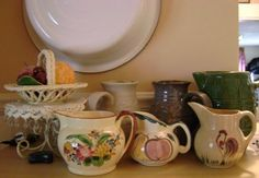 I collect pottery pitchers. Here are a few that are in my collection.