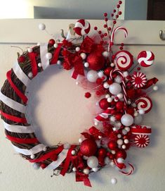 Candy Christmas wreath made by Elissa Pearson...I like the side decorations but not to find of the wrapping.