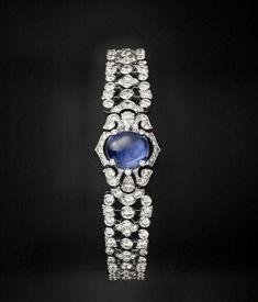 Cartier Secret Hour Watch with Sapphire and Diamonds. Cartier Diamond Bracelet, Cartier Jewelry, Sapphire Bracelet, Sapphire Diamond, Blue Sapphire, Jewelry Bracelets, Bangles, Diamond Necklaces, Sapphire Jewelry