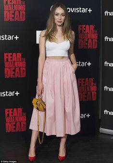Simple and sophisticated: Alycia Debnam-Carey looked pretty in a white crop top and long p...