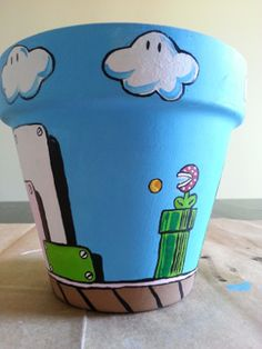 Because who can go wrong with a Mario inspired flower pot? Painted Plant Pots, Painted Flower Pots, Flower Pot Crafts, Clay Pot Crafts, Decorated Flower Pots, Decorated Jars, Pottery Painting, Terracotta Pots, Mason Jar Crafts