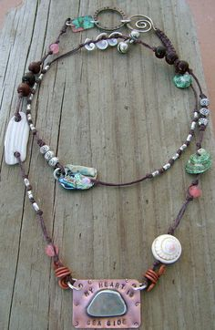 My heart belongs to the sea...does yours?  Waxed Irish linen is the base for this woven and knotted necklace, filled with beach ephemera, sterling silver beads and a bezel set sea glass focal.  <3