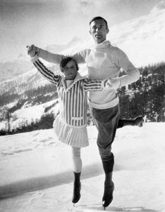 """whataboutbobbed: """" eleven-year-old Sonja Henie stands with world champion figure skater Gilles Grafstrom at the 1924 Games. Gramstrom won the Olympic gold while Hennie would go on to win the gold in 1928, 1932, and 1936 """""""