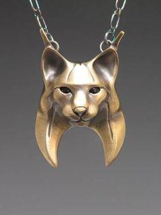handcrafted bronze animal totem jewelry, bobcat totem jewelry