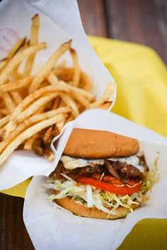 """Best burgers in DFW: OFF-SITE KITCHEN -- Nick Badovinus caramelizes onions into the top of the patty, """"Route 66-style,"""" as he puts it, melts Swiss on it and slathers it with a good house-made barbecue sauce to make the Que'd Onion & Swiss Burger at Off-Site Kitchen, 2226 Irving Blvd., Dallas."""