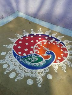 Peacock rangoli                                                                                                                                                                                 More