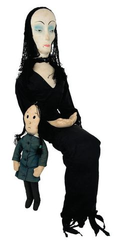 """The 56"""" tall Morticia with the 19"""" tall Wednesday doll produced by Aboriginals in 1962, these are very rare."""