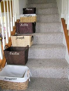Stair baskets to organize clutter - at end of day they have to put everything in their basket away or else it's taken ransom!