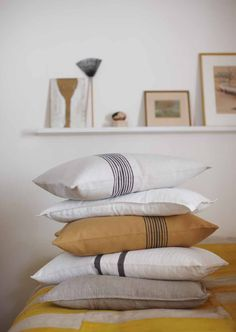 stripe pillows...it would be easy enough to sew a ribbon on or embroider some pillow cases