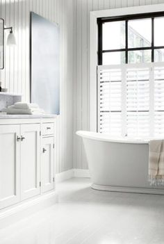 We are having white bathroom shutters over the window above our free standing bath like this image.