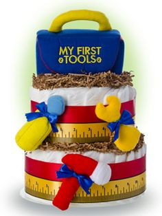 Start the new lil' handyman off with his first tool box set.  This baby diaper cake makes a perfect gift for the family that enjoys honey do's.  This simple design is topped off with a Baby Gund™  Baby's First Tool Box Plush Set. Only $65.00