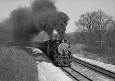 Atchison, Topeka & Santa Fe extra freight train with 2-8-2 steam locomotives nos. 3162 and 3160 climbs Olathe Hill west of Zarah, Kansas, on March 31, 1946.