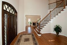 Versailles Model - Beautiful custom entryway with curving stairs. Stairs, Decor, Versailles, Luxury, Luxury Living, Home Decor, Entryway