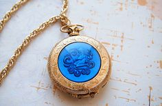 How this blue Aquarius locket opens at the top, like a pocket watch. | 14 Vintage Locket Details That Are Utterly Delightful