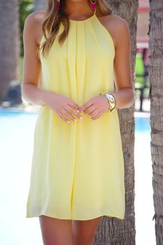 This dress rocks a classic A-line shape in a summer-ready worthy color! Dress is lined and has a button keyhole detail in the back. $38.00