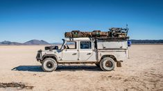 It was a scorching hot day last summer at the Northwest Overland Rally when I sauntered past a well-traveled Defender 130 with dual roof top tents and a South African flag on the fender. Overland events are rife with well-built vehicles, but all too few Top Tents, Roof Top Tent, Land Rover Defender 130, Landrover Defender, Defender Camper, South African Flag, Photos Of The Week, Rooftop, South America