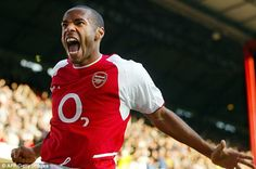 Thierry Henry celebrating scoring against Chelsea in 2003