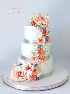 Cascading Flowers Wedding Cake by MimisSweetTreats - http://cakesdecor.com/cakes/277198-cascading-flowers-wedding-cake